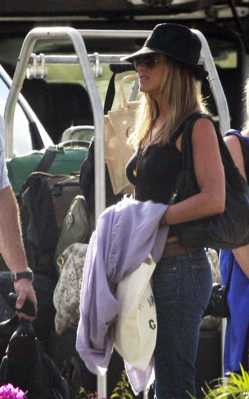 EXCLUSIVE:  Jennifer Aniston and Gerard Butler Take Private Jet